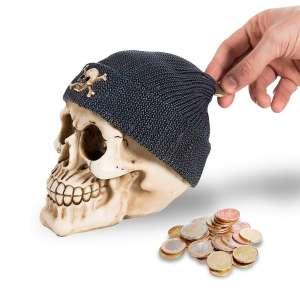 Tirelire en forme de crâne avec un bonnet noir pirate