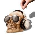 Tirelire crâne à lunettes et casque audio