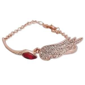 Bracelet doré, faux diamant rouge et aile brillante