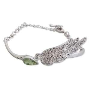 Bracelet fantaisie argenté, faux diamant vert et aile en strass