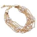 Bracelet aux 9 chainettes dorées parées de perles blanches