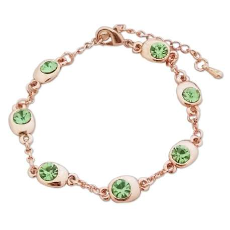 Bracelet doré aux 7 écrins remplis de fausses pierres vertes