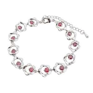 Bracelet aux fleurs argentées et pistils de faux cristaux rouges