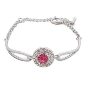 Bracelet argenté au palet de strass et faux cristal rose