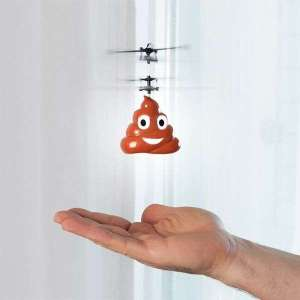 Hélicoptère en forme d'émoticône caca à contrôler avec la main
